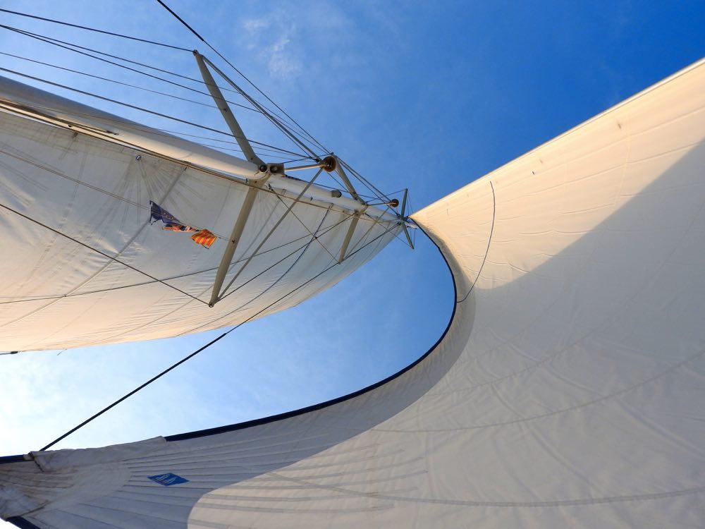 boat trip sunset barcelona sails catamaran