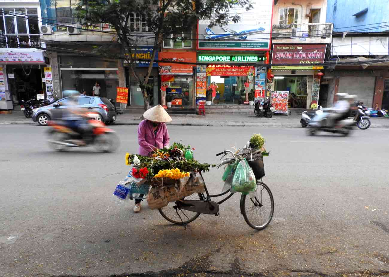 hanoi vs ho chi minh city saigon comparison better travel street shopping